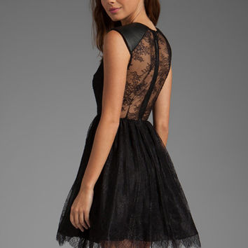 Alice + Olivia Shelly Leather Detailed Boatneck Mini Dress in Black from REVOLVEclothing.com