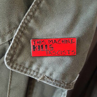 This Machine Kills Fascists Woody Guthrie enamel pin