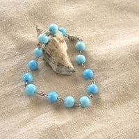 Light blue glass beaded bracelet with matching cluster earrings