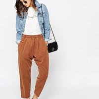 ASOS Washed Casual Tapered Peg Trousers at asos.com