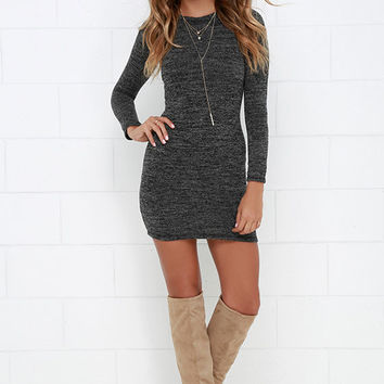 In the Simpli-City Black and Ivory Sweater Dress