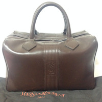 Vintage Yves Saint Laurent genuine dark brown leather daily use duffle bag. Classic unisex style YSL purse