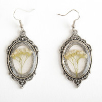 Beautiful women's handmade vintage earrings with dried flowers and epoxy