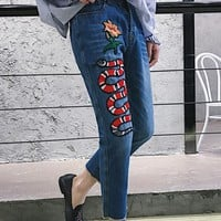 GUCCI Snake embroidering jeans women Nine minutes of pants blue