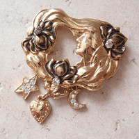 Kirks Folly Charm Brooch Art Nouveau Gold Tone Cupid with Heart Crescent Moon Star V0583