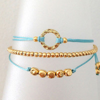 Triple Gold and Light Blue Friendship Bracelet with Adjustable Cord