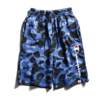 Champion & Aape New fashion casual camouflage pants with men and women rope sports shorts Blue