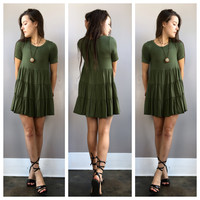 A Babydoll Teired Dress in Olive